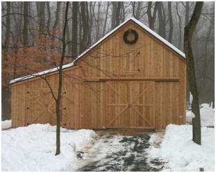 This version of the stock Maple Barn was built in Maryland. Read more and check out the inexpensive building plans at BackroadHome.net