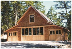 A custom Craftsman style coach house built with the help of pole-barn plans from BackroadHome.net